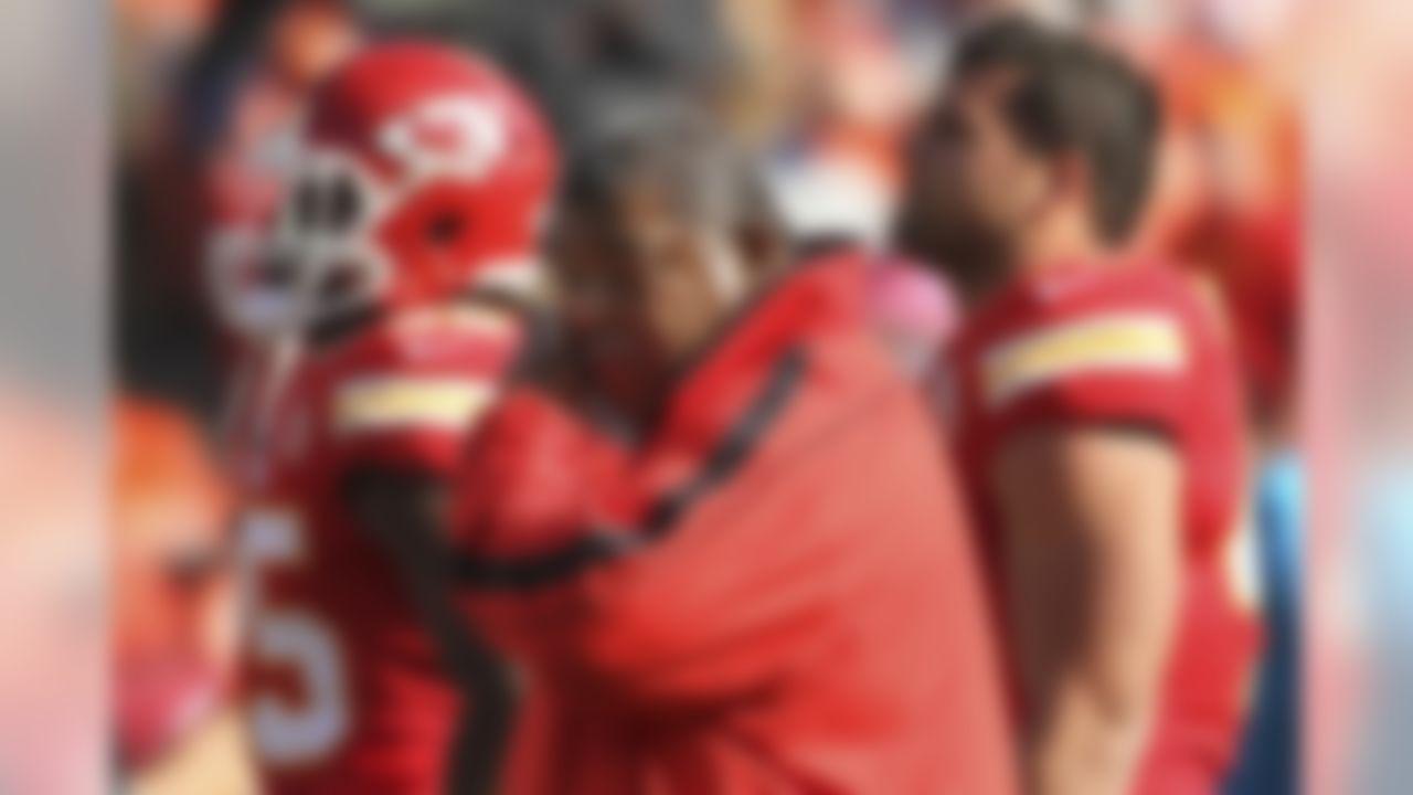 Kansas City Chiefs coach Romeo Crennel wipes his eyes on an emotional Sunday at Arrowhead Stadium. (AP Photo/Colin E. Braley)