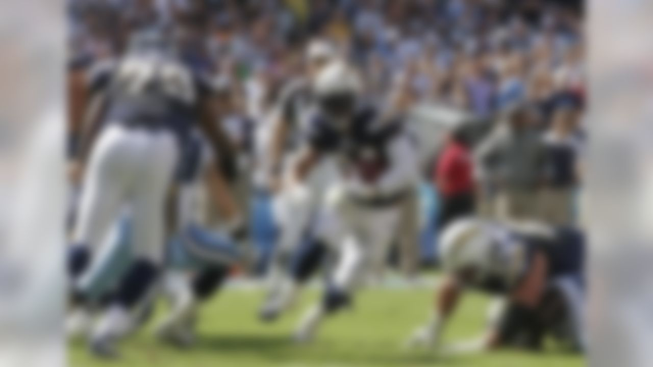 San Diego Chargers running back Ryan Mathews, center, finds a hole in the Tennessee Titans defense while running for a five-yard gain during the first half of an NFL football game on Sunday, Oct. 31, 2010, in San Diego. (AP Photo/Gregory Bull)