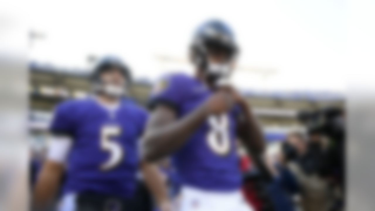Baltimore Ravens quarterbacks Lamar Jackson (8) and Joe Flacco walk onto the field before an NFL wild card playoff football game against the Los Angeles Chargers, Sunday, Jan. 6, 2019, in Baltimore. (AP Photo/Nick Wass)