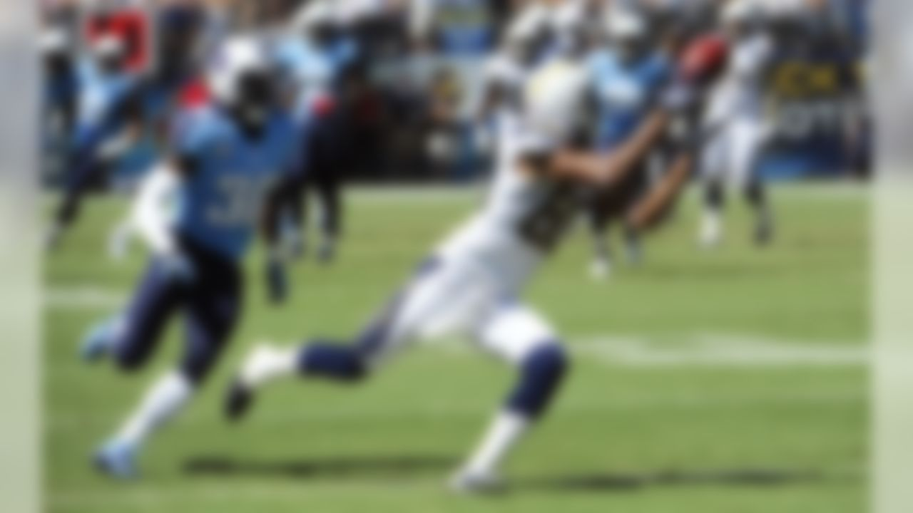 San Diego Chargers wide receiver Malcom Floyd, right, makes a catch as Tennessee Titans cornerback Jason McCourty, left, cannot catch up during the first quarter of an NFL football game on Sunday, Sept. 16, 2012, in San Diego. (AP Photo/Denis Poroy)