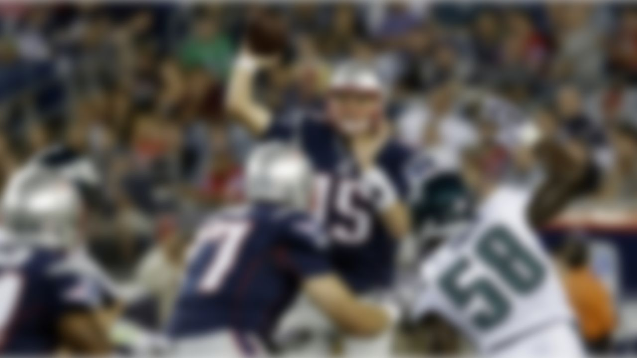 New England Patriots quarterback Ryan Mallett (15) throws as he is pressured by Philadelphia Eagles defensive end Trent Cole (58) during the first quarter of an NFL preseason football game in Foxborough, Mass., Monday, Aug. 20, 2012.(AP Photo/Elise Amendola)