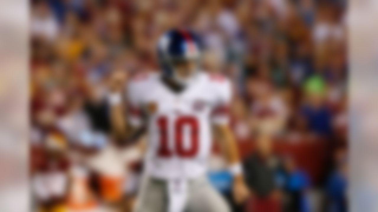 New York Giants quarterback Eli Manning (10) celebrates after scoring against the Washington Redskins during an NFL football game at FedEx Field on Thursday September 25, 2014 in Landover, Maryland. (Aaron M. Sprecher/NFL)