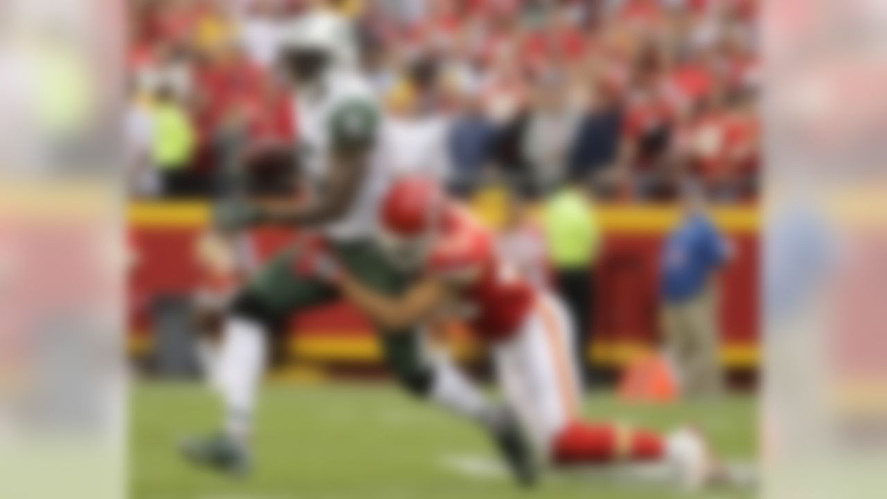 New York Jets wide receiver Brandon Marshall (15) is tackled by Kansas City Chiefs defensive back Phillip Gaines (23) during the first half of an NFL football game in Kansas City, Mo., Sunday, Sept. 25, 2016. (AP Photo/Charlie Riedel)