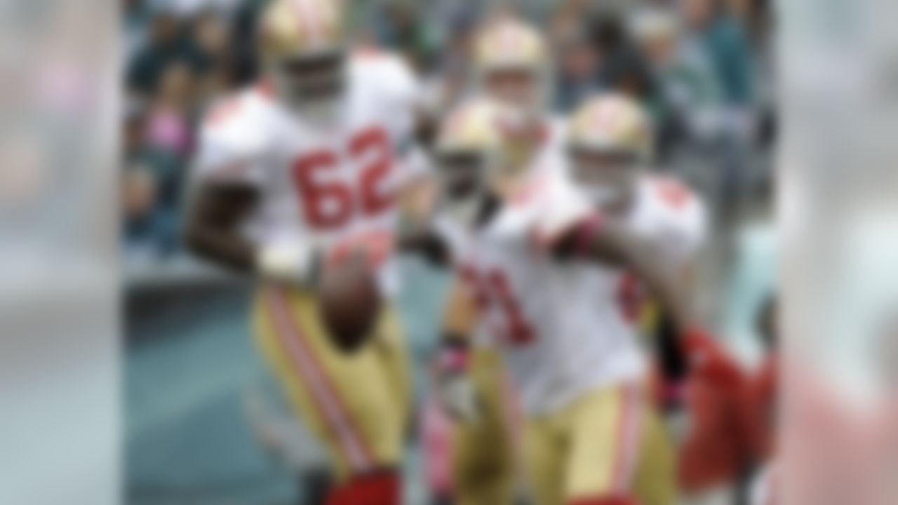 San Francisco 49ers running back Frank Gore (21) celebrates with teammates after his touchdown in the second half of an NFL football game against the Philadelphia Eagles Sunday, Oct. 2, 2011, in Philadelphia. The 49ers won 24-23. (AP Photo/Michael Perez)