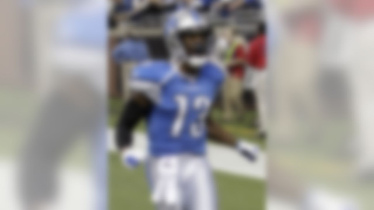 Detroit Lions wide receiver Nate Burleson (13) celebrates his touchdown during the second quarter of an NFL football game against the San Diego Chargers in Detroit, Saturday, Dec. 24, 2011. (AP Photo/Carlos Osorio)