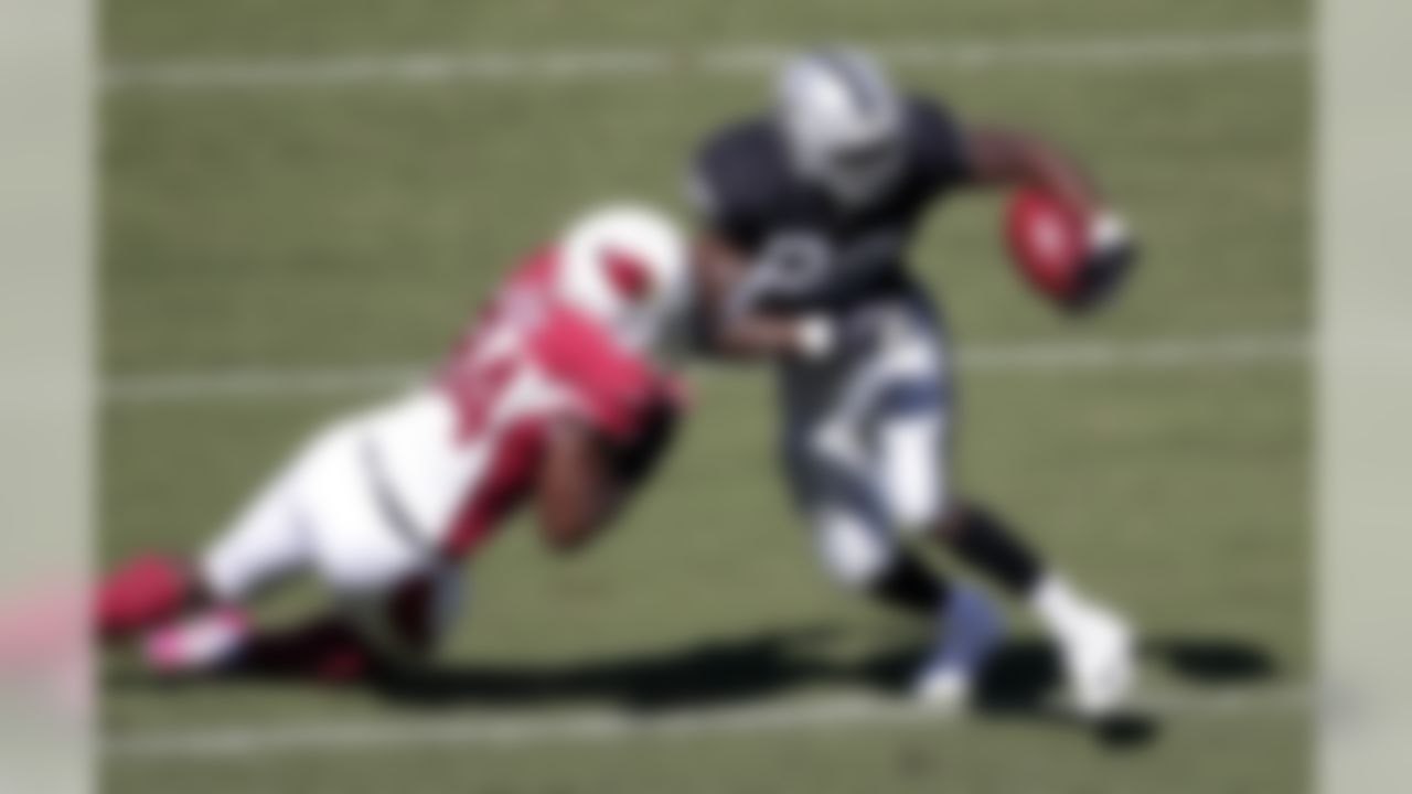 Oakland Raiders running back Darren McFadden (20) is tackled by Arizona Cardinals outside linebacker Sam Acho (94) during the first quarter of an NFL football game in Oakland, Calif., Sunday, Oct. 19, 2014. (AP Photo/Marcio Jose Sanchez)