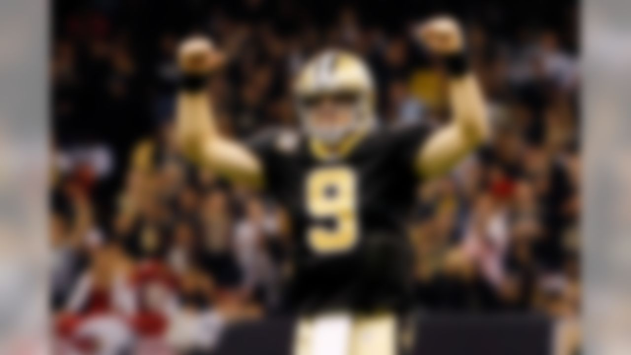 New Orleans Saints quarterback Drew Brees (9) celebrates a touchdown against the Arizona Cardinals at The Louisiana Superdome in New Orleans, Louisiana on January 16, 2010. (Aaron M. Sprecher/NFL.com)