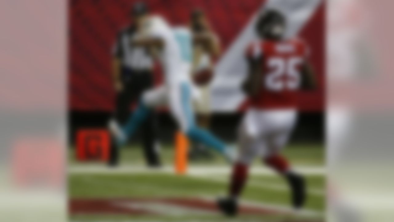 Miami Dolphins wide receiver Brandon Gibson (10) runs into the end zone against Atlanta Falcons strong safety William Moore (25) during the first half of an NFL preseason football game, Friday, Aug. 8, 2014, in Atlanta.  (AP Photo/John Bazemore)