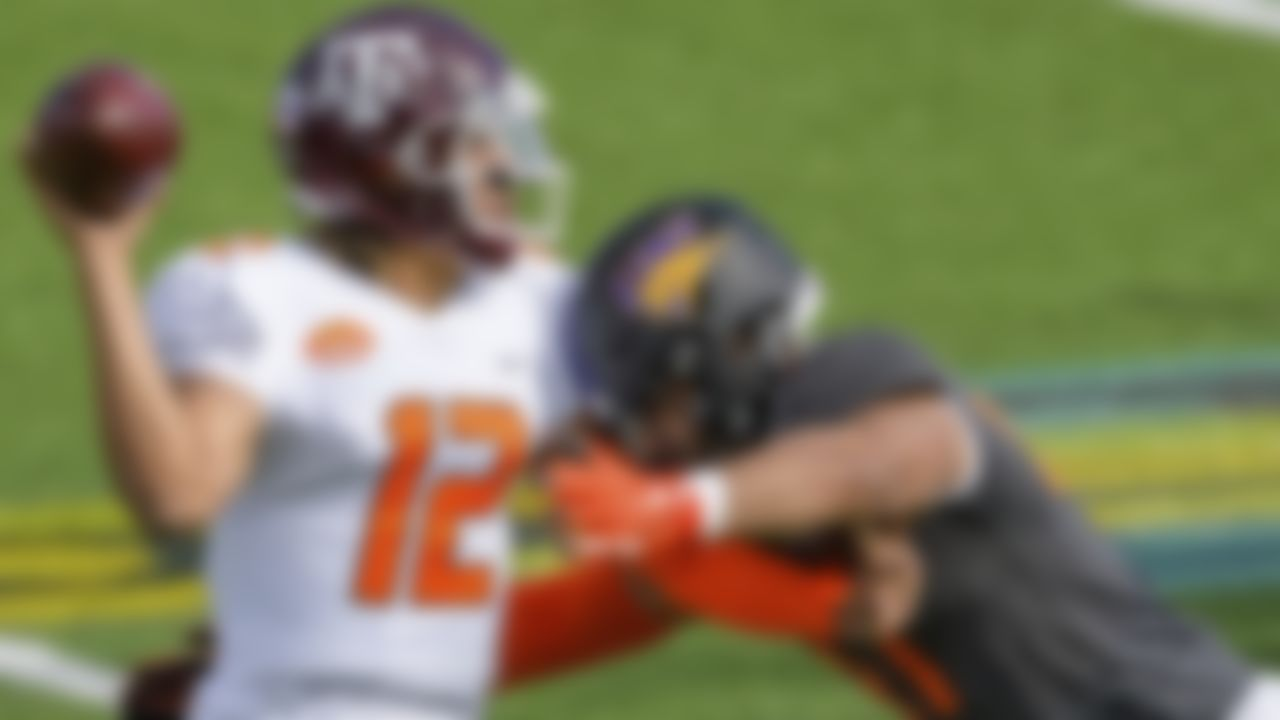 American Team quarterback Kellen Mond of Texas A&M (12) throws against National Team offensive lineman Spencer Brown of Northern Iowa(FCS) (76) during the NCAA Senior Bowl college football game in Mobile, Ala., Saturday, Jan. 30, 2021.