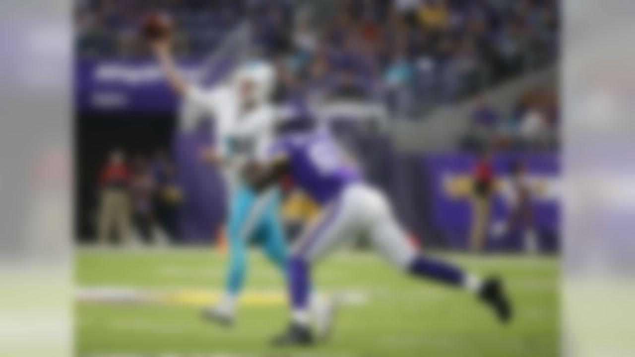Minnesota Vikings defensive end Stephen Weatherly pressures Miami Dolphins quarterback Brandon Doughty (7) during the first half of an NFL preseason football game, Thursday, Aug. 31, 2017, in Minneapolis. (AP Photo/Bruce Kluckhohn)