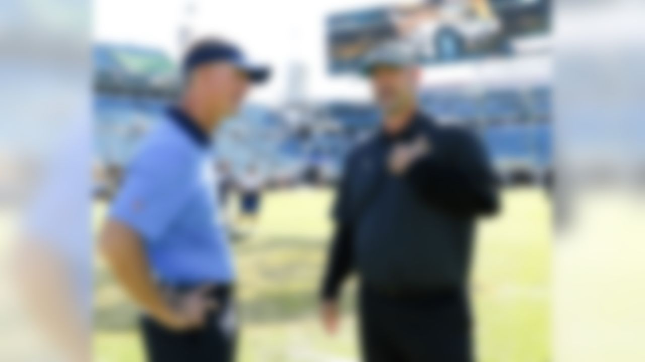 San Diego Chargers head coach Mike McCoy, left, and Jacksonville Jaguars head coach Gus Bradley talks on the field before an NFL football game in Jacksonville, Fla., Sunday, Nov. 29, 2015. (AP Photo/Stephen B. Morton)