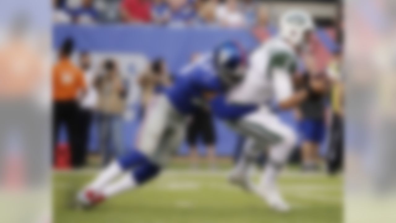 New York Giants free safety Darian Thompson (27) sacks New York Jets quarterback Christian Hackenberg (5) during the first half of a preseason NFL football game Saturday, Aug. 26, 2017, in East Rutherford, N.J. (AP Photo/Julio Cortez)