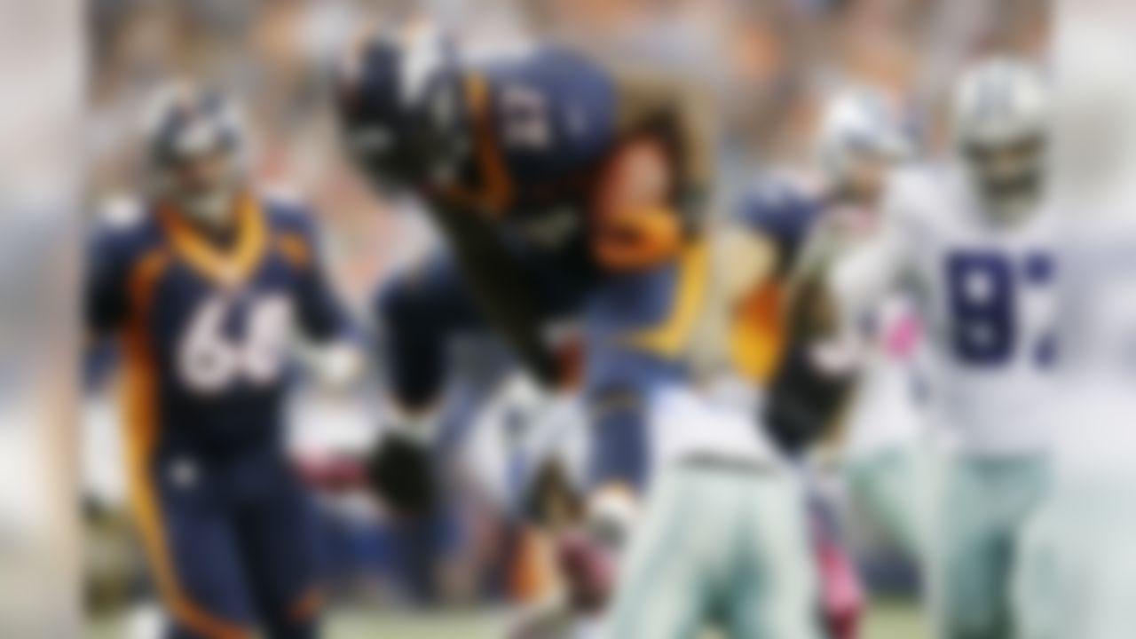 Denver Broncos running back Knowshon Moreno (27) hurdles J.J. Wilcox (27) during the second quarter of an NFL football game Sunday, Oct. 6,2013, in Arlington, Texas. (AP Photo/Tony Gutierrez)