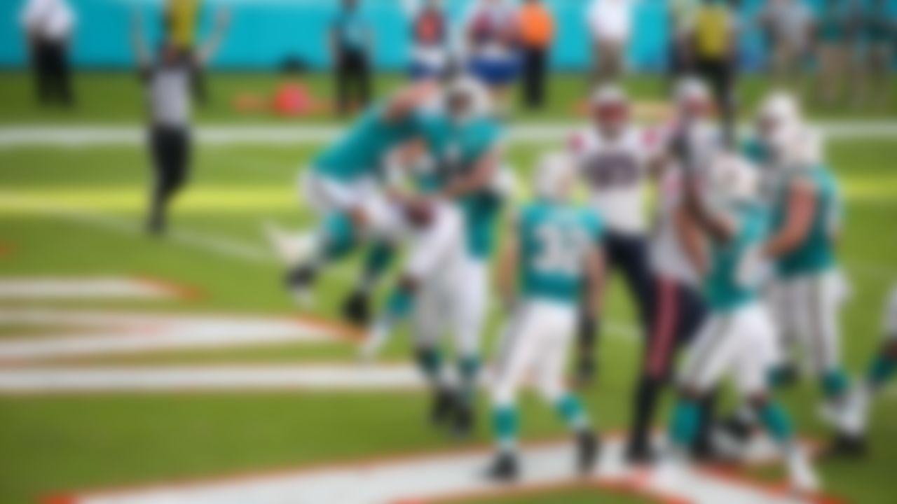 Miami Dolphins quarterback Tua Tagovailoa (1) celebrates with teammates in Sunday's victory over the New England Patriots.