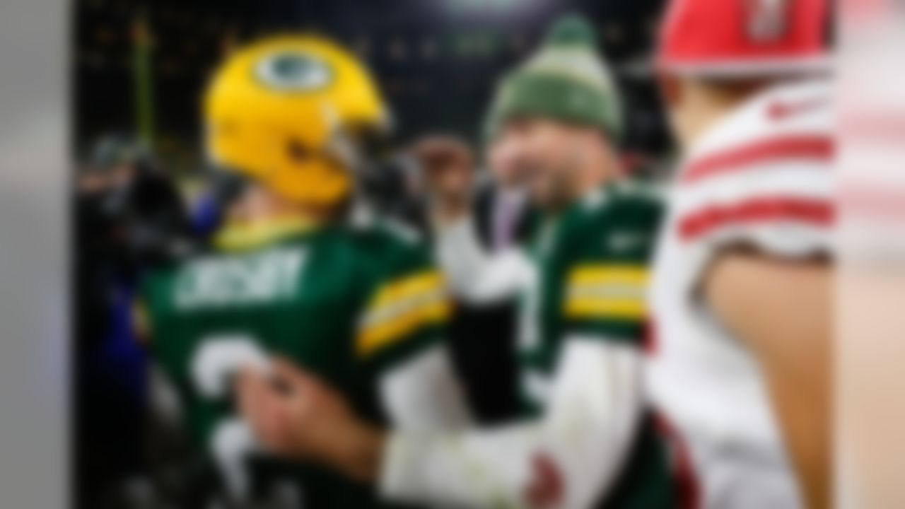 Green Bay Packers quarterback Aaron Rodgers (12) celebrates with kicker Mason Crosby (2) after kicking the winning field goal following an NFL football game against the San Francisco 49ers on Monday, Oct. 15, 2018, in Green Bay, Wis. (Ryan Kang/NFL)