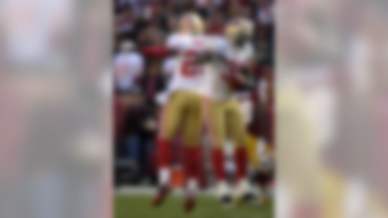 San Francisco 49ers strong safety Donte Whitner, right, celebrates with teammate Tarell Brown after recovering a fumble in the first half of an NFL football game against the Washington Redskins in Landover, Md., Sunday, Nov. 6, 2011. (AP Photo/Cliff Owen)