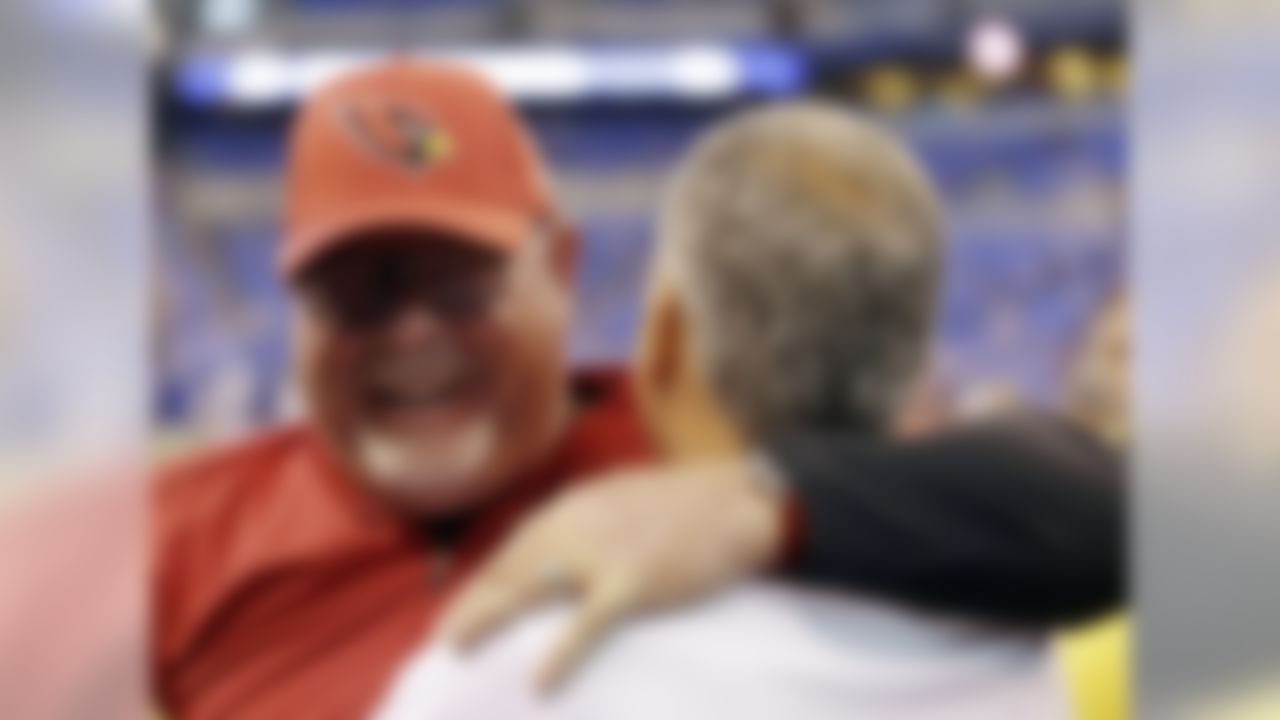Arizona Cardinals head coach Bruce Arians, left, talks with Indianapolis Colts head coach Chuck Pagano before an NFL football game Sunday, Sept. 17, 2017, in Indianapolis. (AP Photo/AJ Mast)