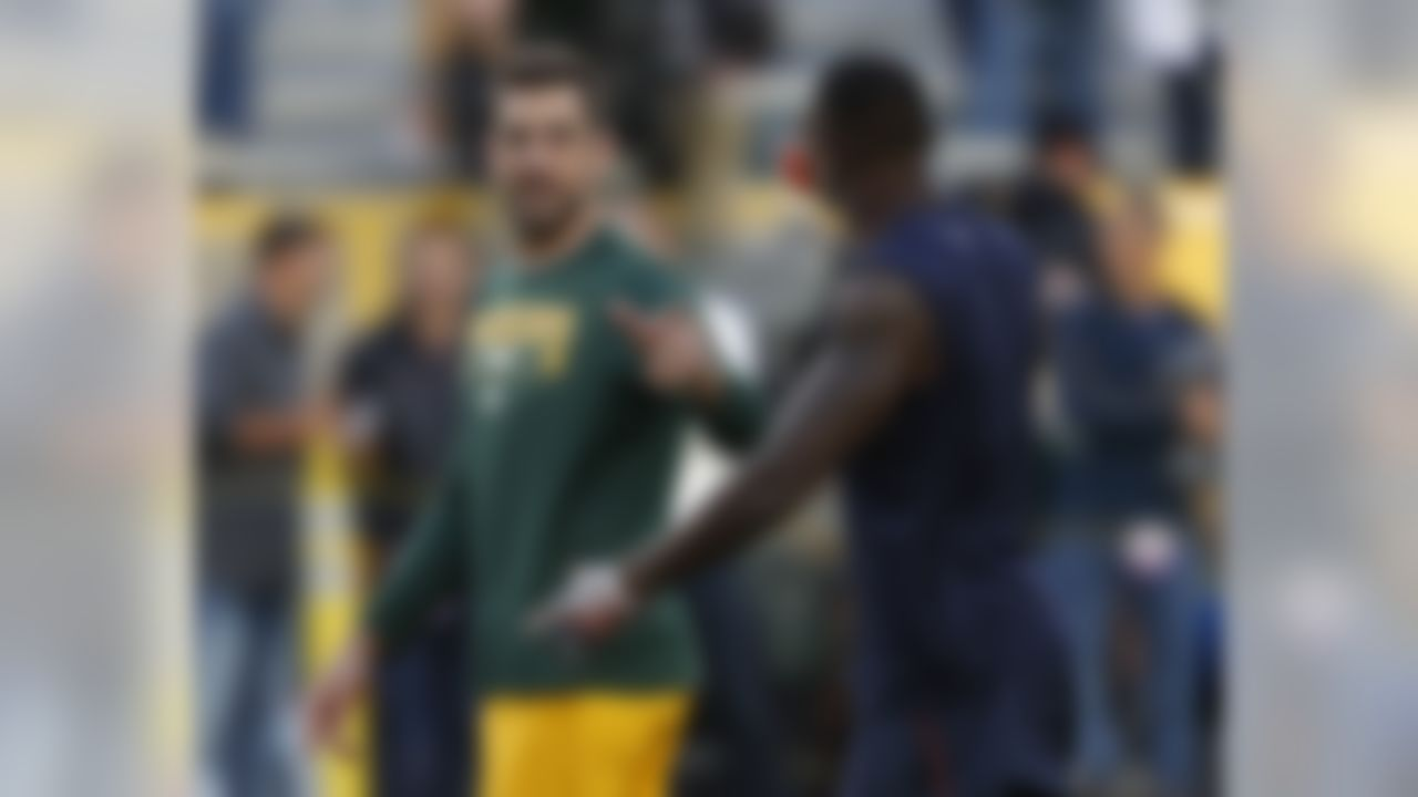 Green Bay Packers' Aaron Rodgers talks to Chicago Bears' Josh Bellamy before an NFL football game Thursday, Sept. 28, 2017, in Green Bay, Wis. (AP Photo/Matt Ludtke)