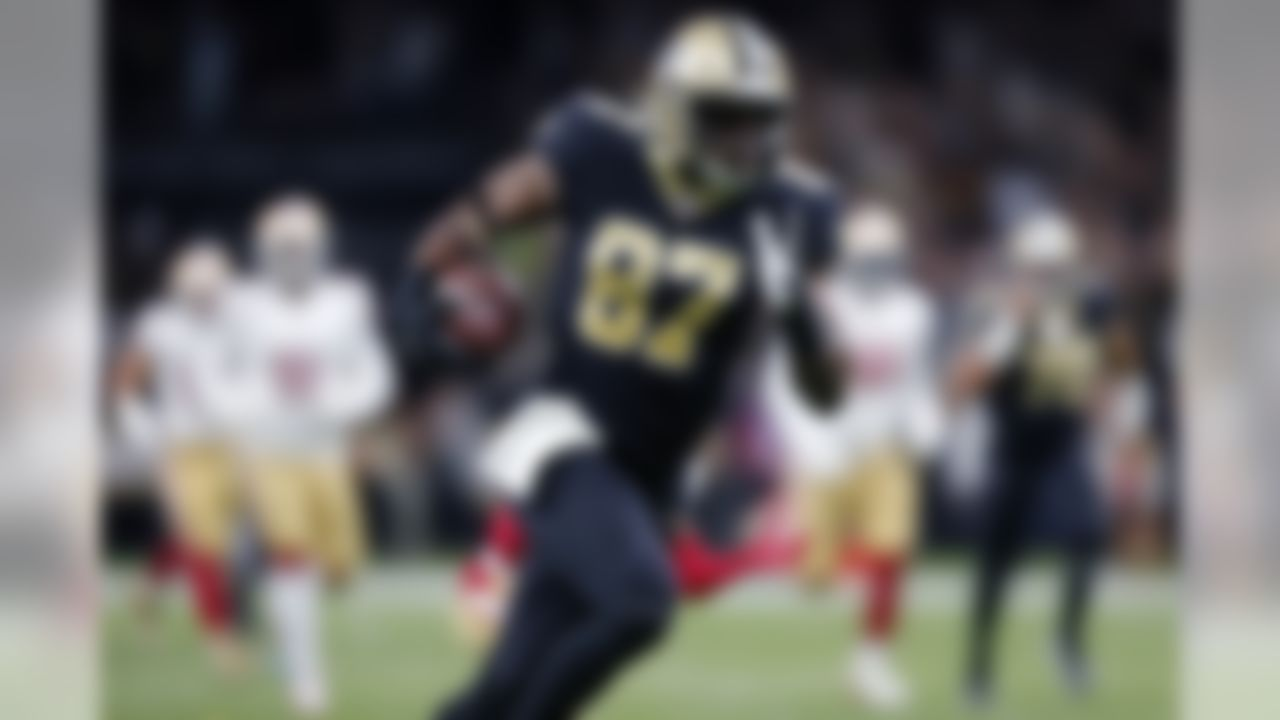 New Orleans Saints tight end Jared Cook (87) carries on a touchdown reception in the first half an NFL football game in New Orleans, Sunday, Dec. 8, 2019. (AP Photo/Brett Duke)