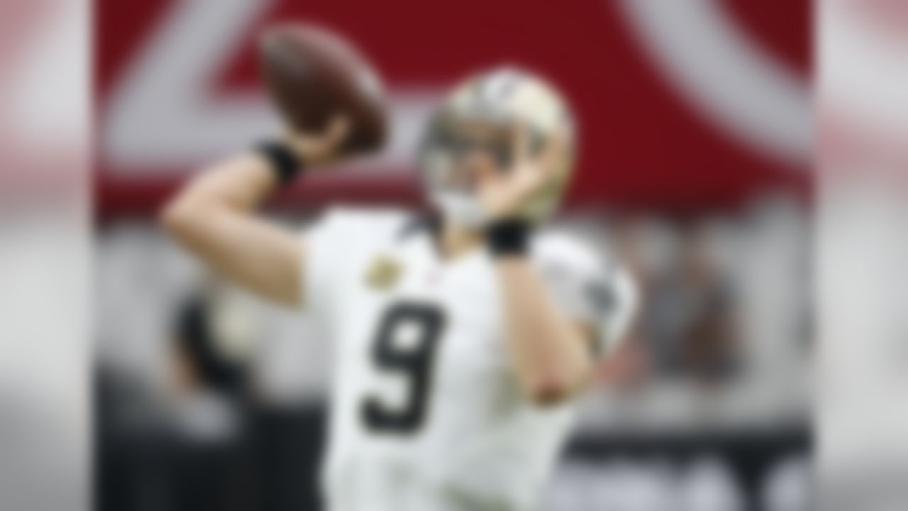 New Orleans Saints quarterback Drew Brees (9) warms up prior to an NFL football game against the Arizona Cardinals, Sunday, Sept. 13, 2015, in Glendale, Ariz. (AP Photo/Ross D. Franklin)