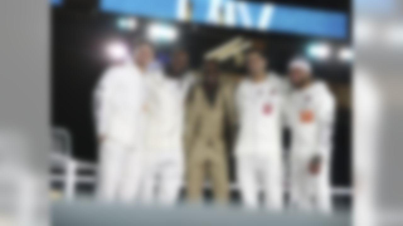 Kansas City Chiefs quarterback Patrick Mahomes (15), San Francisco 49ers cornerback Richard Sherman (25), Deion Sanders, San Francisco 49ers quarterback Jimmy Garoppolo (10) and Kansas City Chiefs strong safety Tyrann Mathieu (32) onstage during Opening Night ahead of Super Bowl LIV, Monday, Jan. 27, 2020 in Miami, Fla.