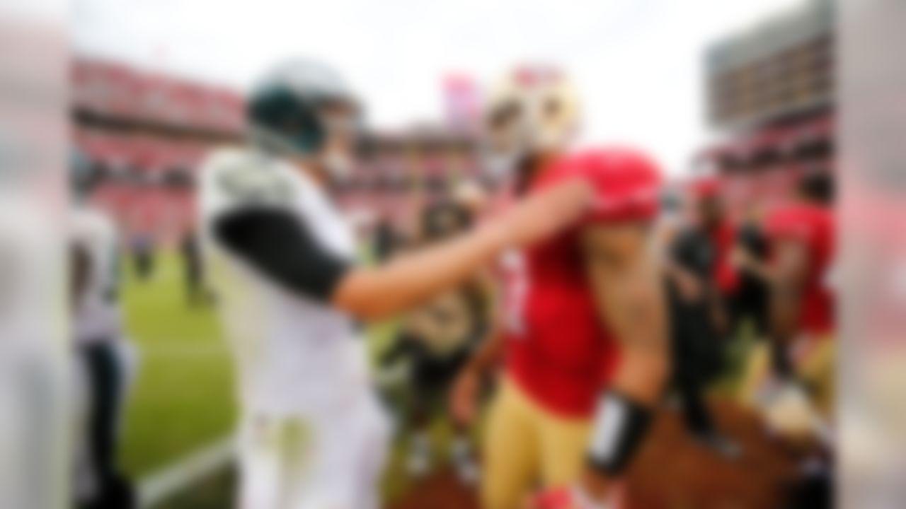 Philadelphia Eagles quarterback Nick Foles (9) talks with San Francisco 49ers quarterback Colin Kaepernick (7) after the NFL regular season game against the Philadelphia Eagles and the San Francisco 49ers on Sunday, Sept. 28, 2014 at the Levi's Stadium in Santa Clara, Calif. (Ric Tapia/NFL)
