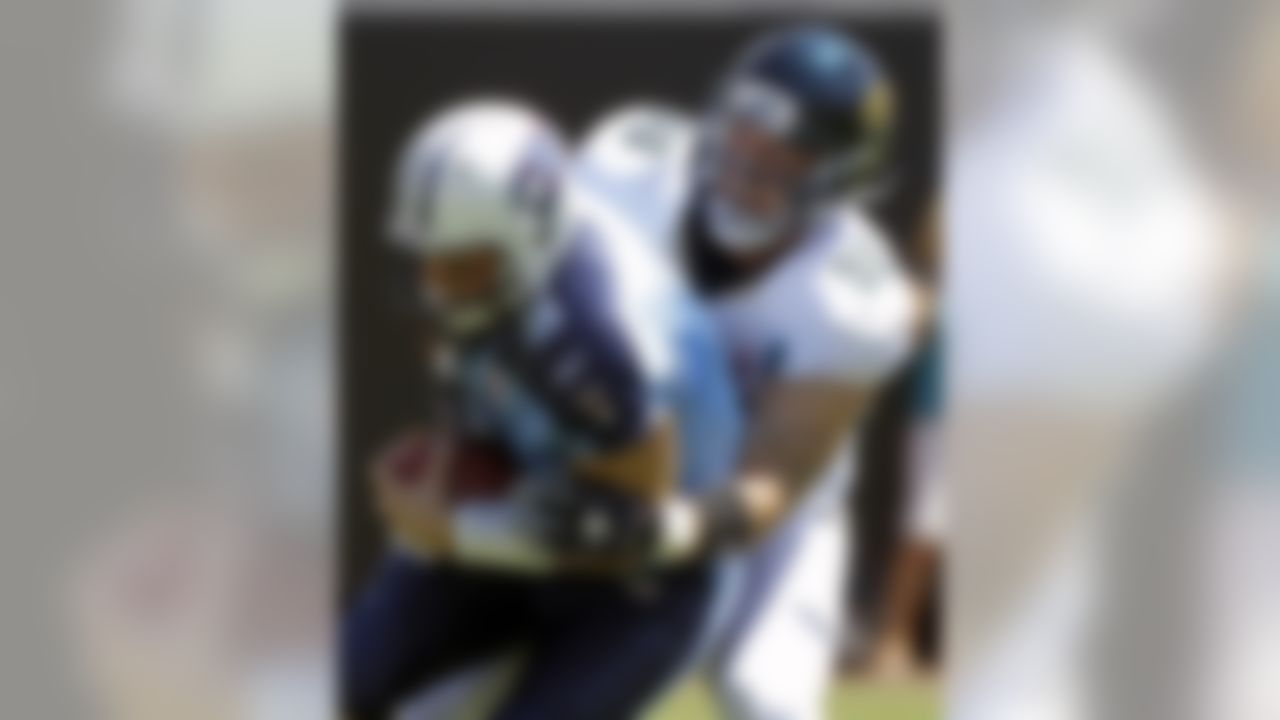 Tennessee Titans quarterback Matt Hasselbeck (8) is sacked by Jacksonville Jaguars linebacker Matt Roth (90) during the first half of an NFL football game  on Sunday, Sept. 11, 2011, in Jacksonville, Fla. (AP Photo/John Raoux)