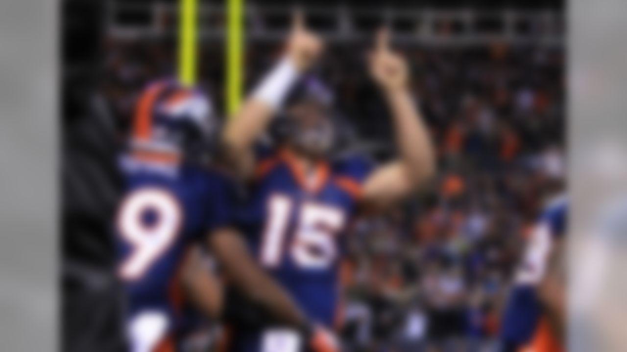 Denver Broncos quarterback Tim Tebow celebrates a touchdown during an NFL football game against the New York Jets at Invesco Field at Mile high Stadium in Denver, Co., on Thursday, Nov. 17, 2011. (AP Photo/Ben Liebenberg)