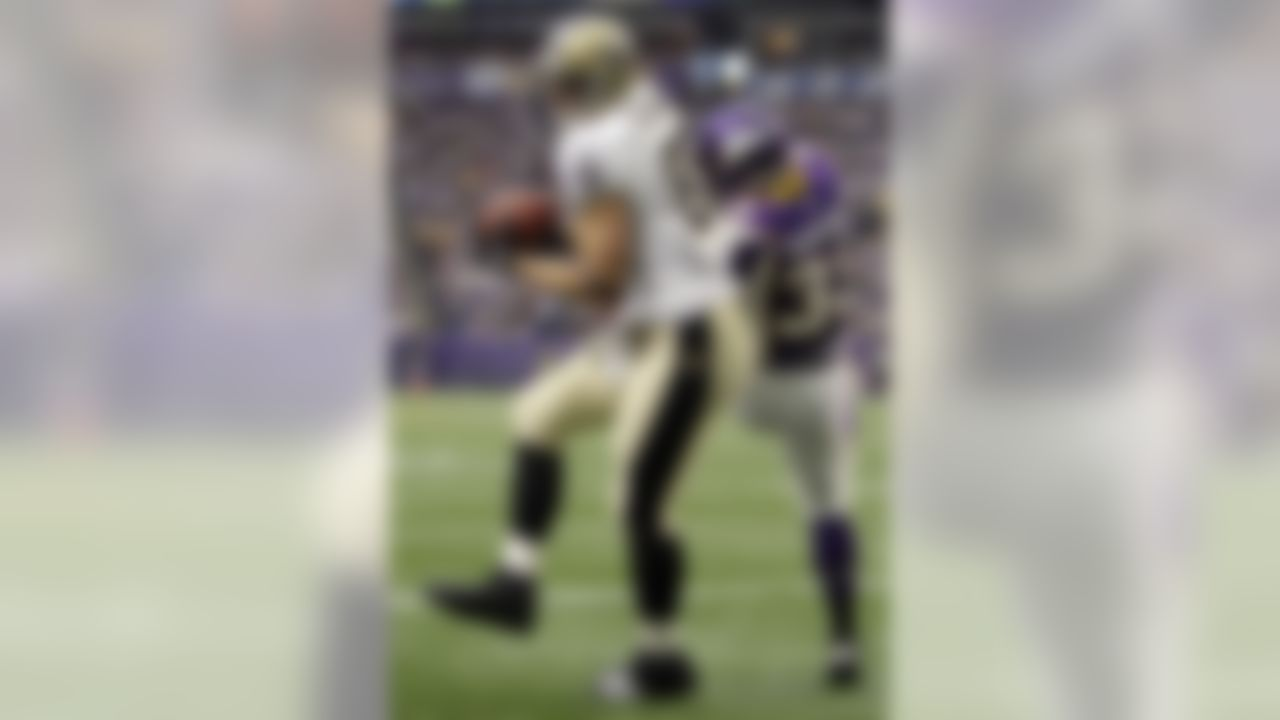New Orleans Saints' Jimmy Graham (80) catches a touchdown pass in front of Minnesota Vikings' Jamarca Sanford (33) during the first half of an NFL football game Sunday, Dec. 18, 2011, in Minneapolis. (AP Photo/Charlie Neibergall)