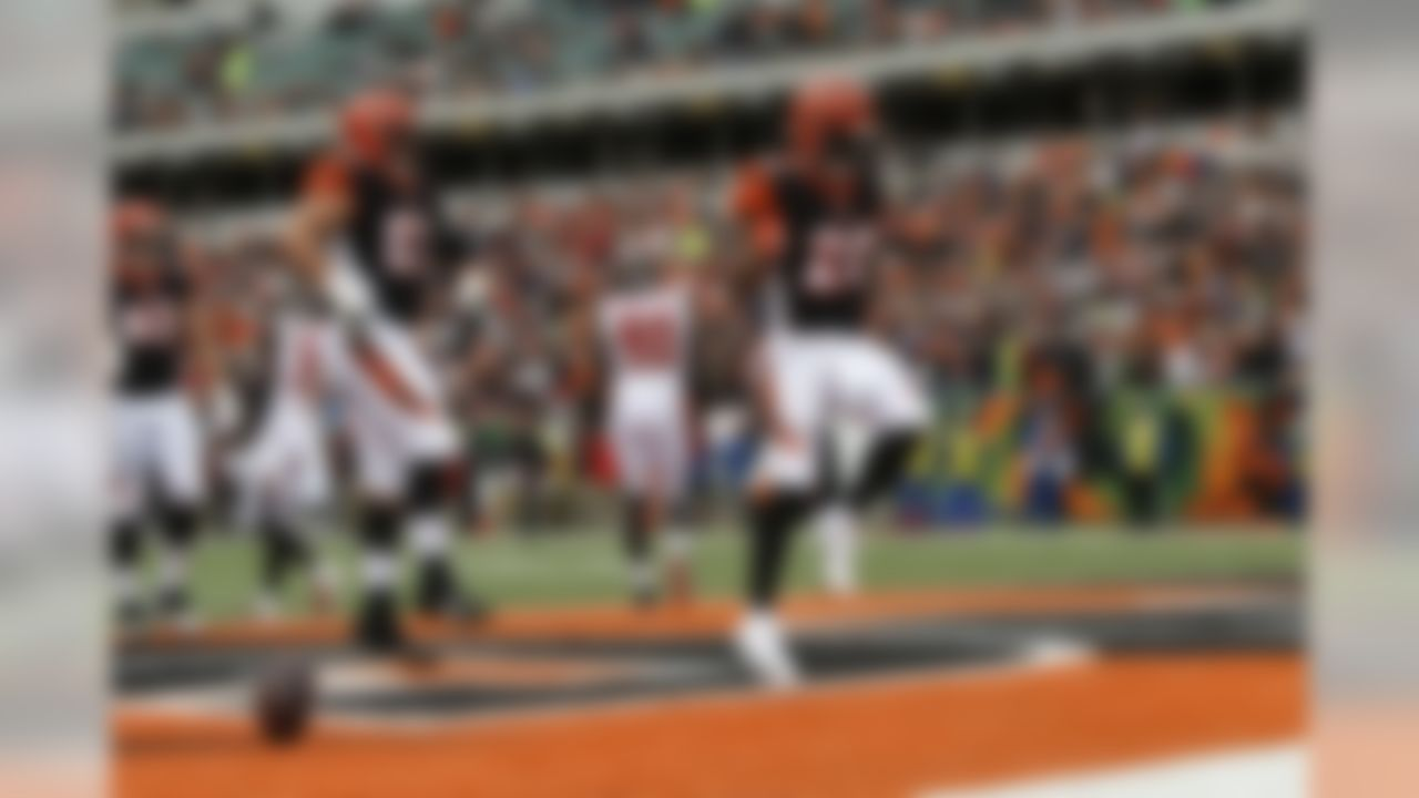 Cincinnati Bengals running back Joe Mixon (28) celebrates a touchdown against the Tampa Bay Buccaneers during the first half of an NFL football game in Cincinnati, Sunday, Oct. 28, 2018. (AP Photo/Frank Victores)