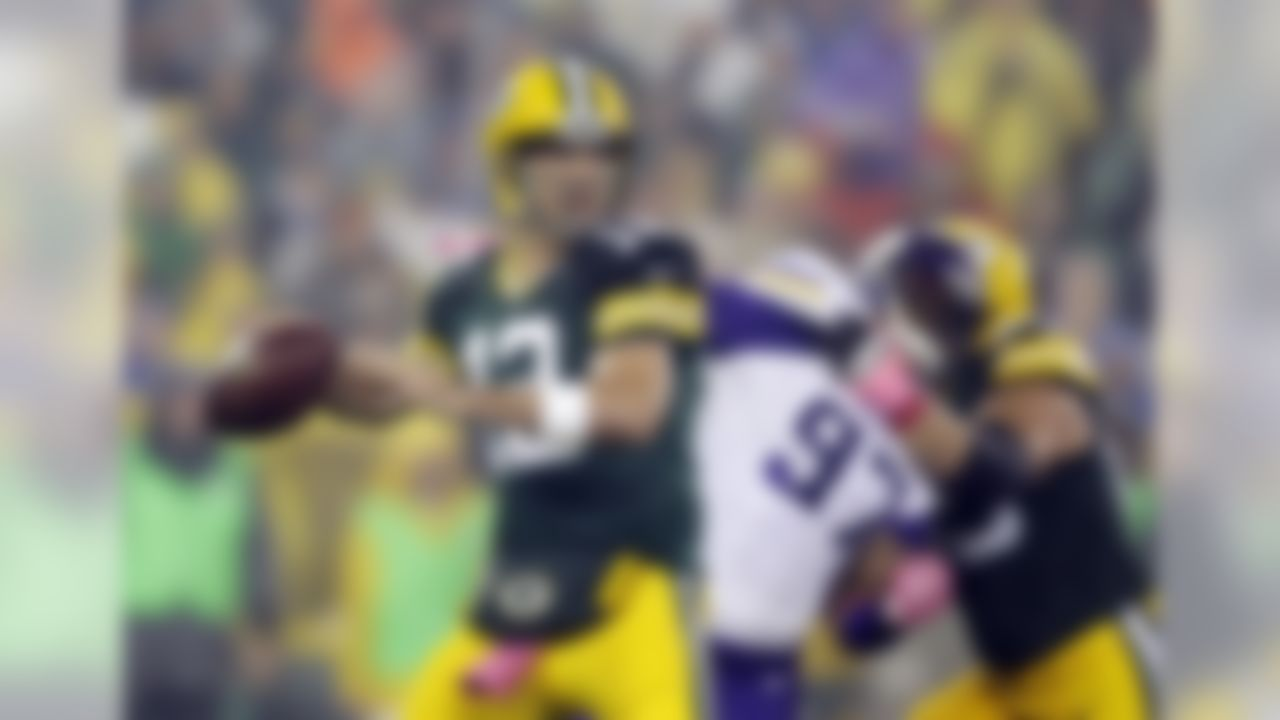 Green Bay Packers' Aaron Rodgers drops back to pass during the first half of an NFL football game against the Minnesota Vikings Thursday, Oct. 2, 2014, in Green Bay, Wis. (AP Photo/Tom Lynn)