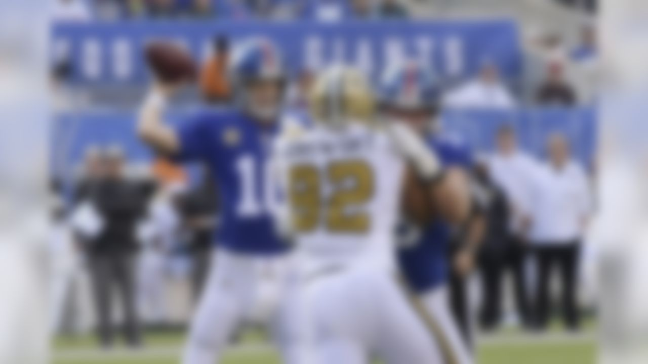 New York Giants quarterback Eli Manning, left, looks to throw during the first half of an NFL football game against the New Orleans Saints, Sunday, Sept. 30, 2018, in East Rutherford, N.J. (AP Photo/Bill Kostroun)