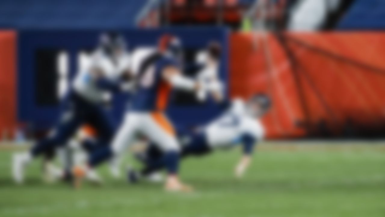 Quarterback Ryan Tannehill (17) throws the ball away at the last second against the Denver Broncos in Tennessee's 16-14 victory in Denver.