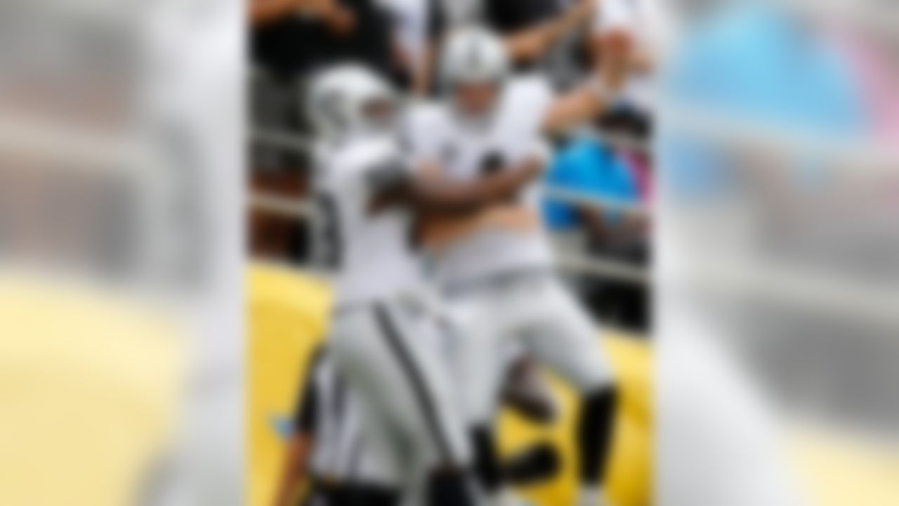 Oakland Raiders tight end Clive Walford (88) and Oakland Raiders quarterback Derek Carr (4) celebrate a touchdown during the NFL regular season game against the San Diego Chargers on Sunday, Oct. 25, 2015 in San Diego. (Ric Tapia/NFL)
