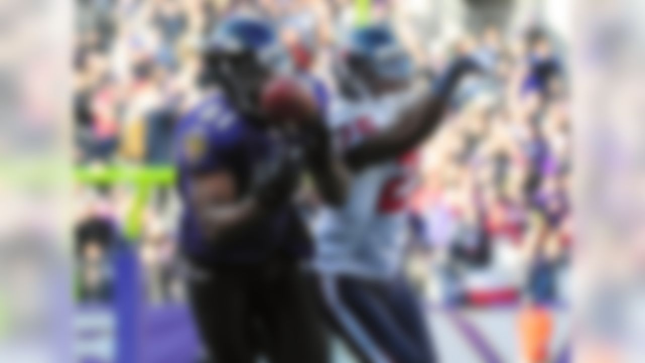 Jan 15, 2012; Baltimore, MD, USA; Baltimore Ravens wide receiver Anquan Boldin (81) makes a catch while being defend by Houston Texans cornerback Kareem Jackson (25) during the second quarter of the 2011 AFC divisional playoff game at M&T Bank Stadium. Mandatory Credit: Andrew Weber-US PRESSWIRE