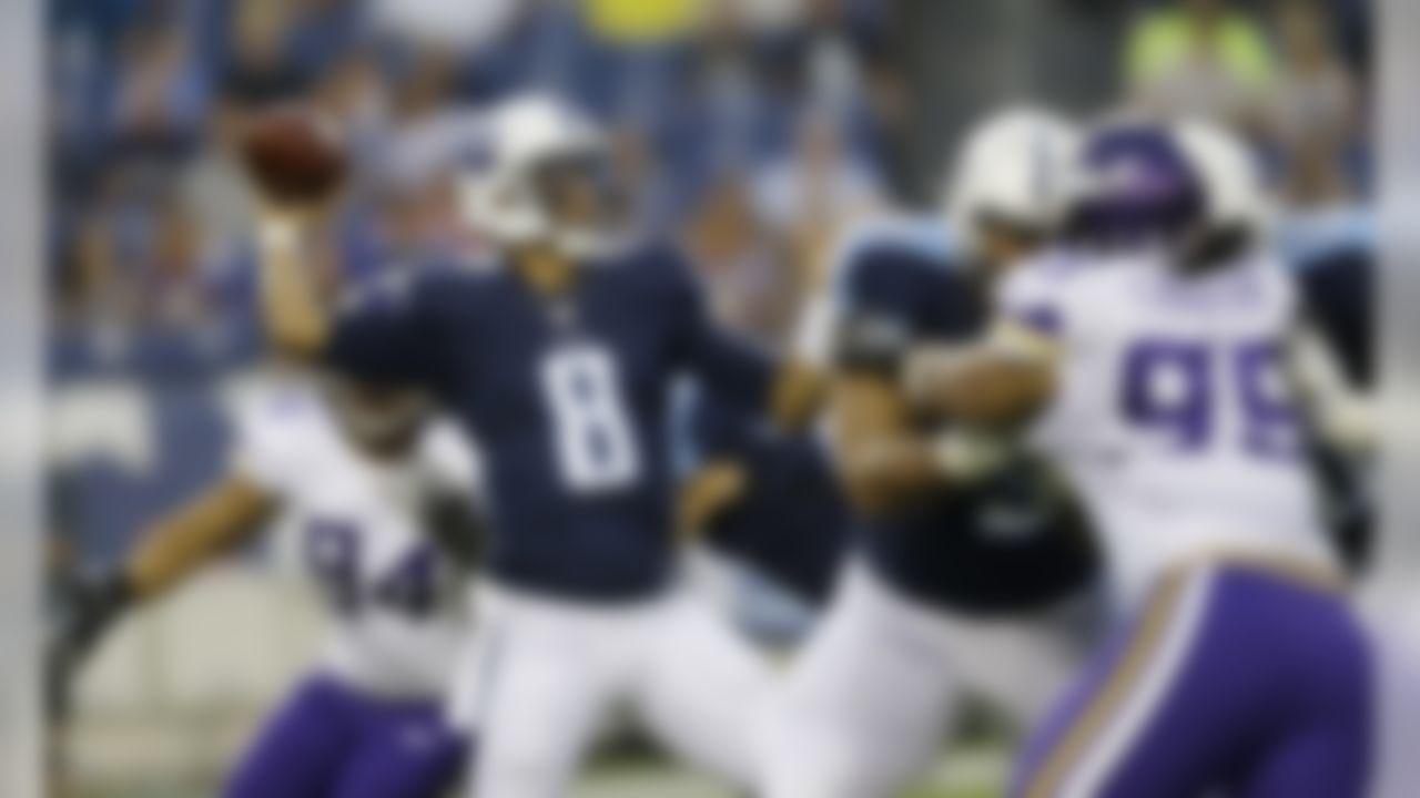 Tennessee Titans quarterback Marcus Mariota (8) passes as Minnesota Vikings defensive end Scott Crichton (95) rushes in the first half of a preseason NFL football game Thursday, Sept. 3, 2015, in Nashville, Tenn. (AP Photo/James Kenney)