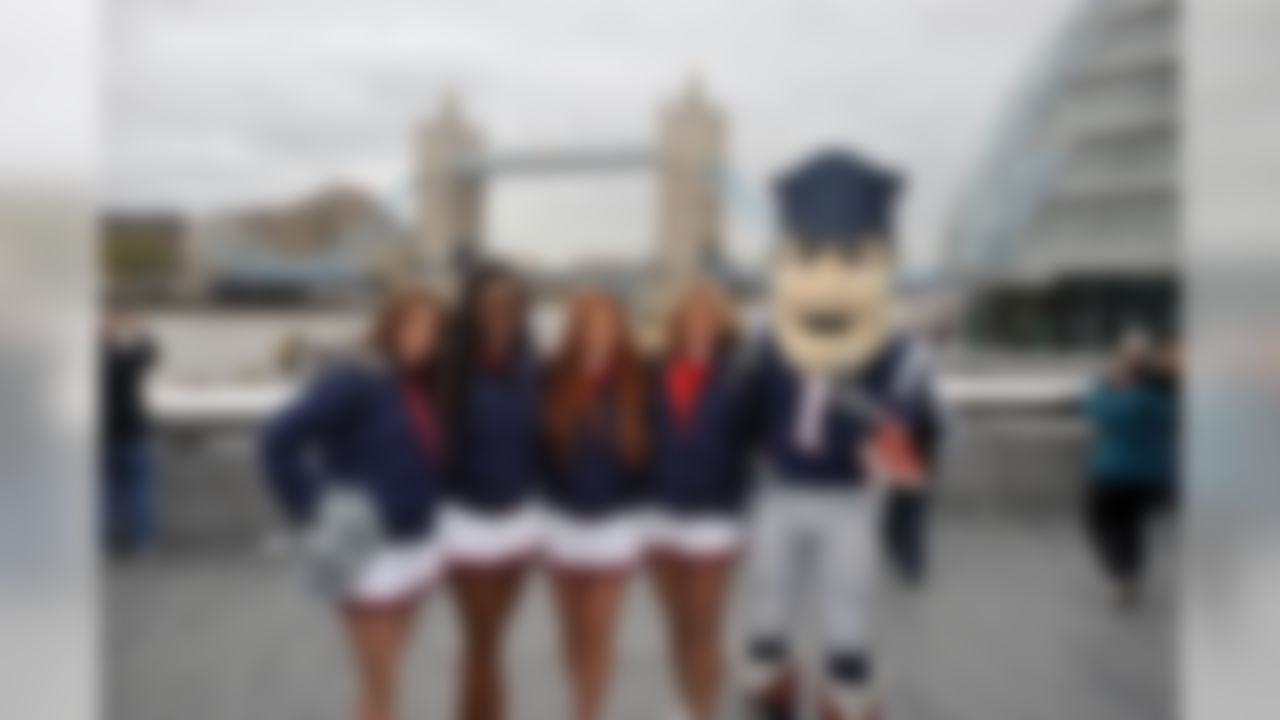 New England Patriots cheerleaders and mascot pose for a photo in London, England on October 26, 2012. (Keith Nordstrom/NFL)