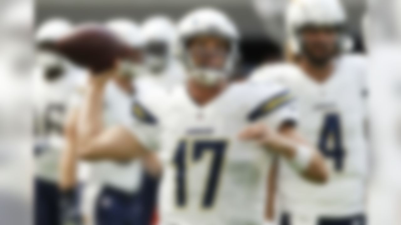 San Diego Chargers quarterback Philip Rivers (17) warms up before an NFL preseason football game against the Minnesota Vikings Sunday, Aug. 28, 2016, in Minneapolis. (AP Photo/Jim Mone)