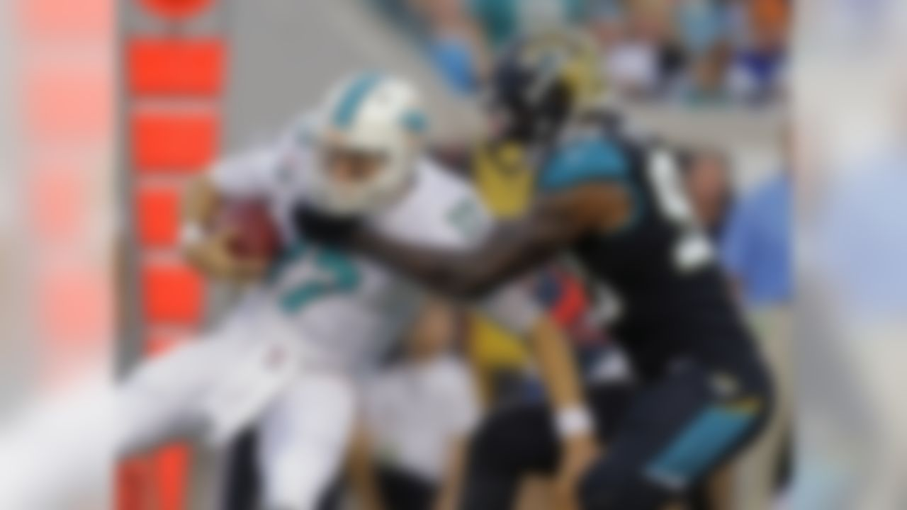 Miami Dolphins quarterback Ryan Tannehill (17) is sacked by Jacksonville Jaguars defensive end Andre Branch (90) during the first half of an NFL preseason football game, Friday, Aug. 9, 2013, in Jacksonville, Fla. (AP Photo/John Raoux)