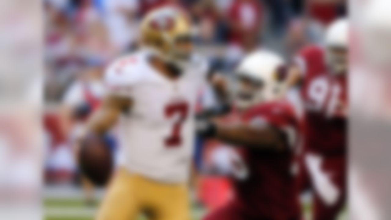 San Francisco 49ers quarterback Colin Kaepernick (7) is pressured by Arizona Cardinals outside linebacker John Abraham during the first half of an NFL football game, Sunday, Dec. 29, 2013, in Glendale, Ariz.  (AP Photo/Rick Scuteri)