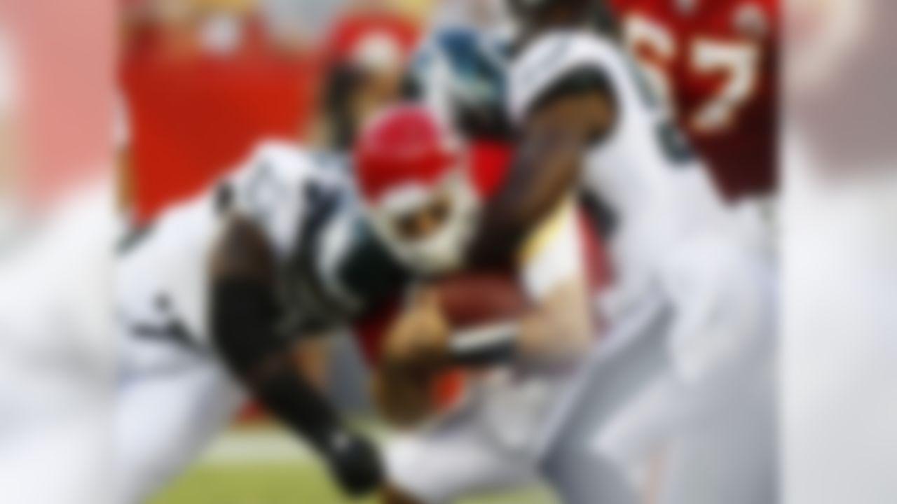 Kansas City Chiefs quarterback Matt Cassel (7) is sacked by Philadelphia Eagles linebacker Ernie Sims (50) and tight end Brent Celek (87) during the first half of a preseason NFL football game in Arrowhead Stadium in Kansas City, Mo., Friday, Aug. 27, 2010. (AP Photo/Ed Zurga)