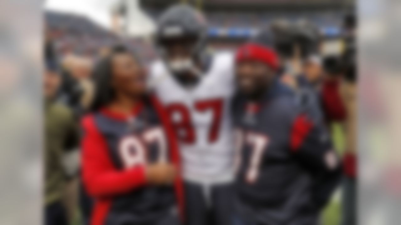 Houston Texans wide receiver Demaryius Thomas (87) stands with his parents, Bobby Thomas, right, and Katina Smith, prior to an NFL football game against the Denver Broncos, Sunday, Nov. 4, 2018, in Denver. (AP Photo/David Zalubowski)