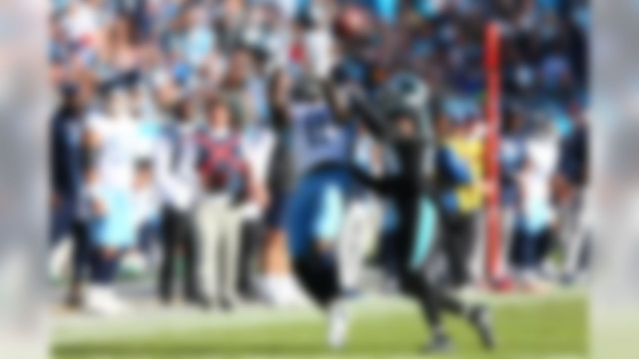 Tennessee Titans wide receiver A.J. Brown (11) catches a pass against Carolina Panthers cornerback James Bradberry (24) during the fourth quarter of an NFL game at Bank of America Stadium. Mandatory