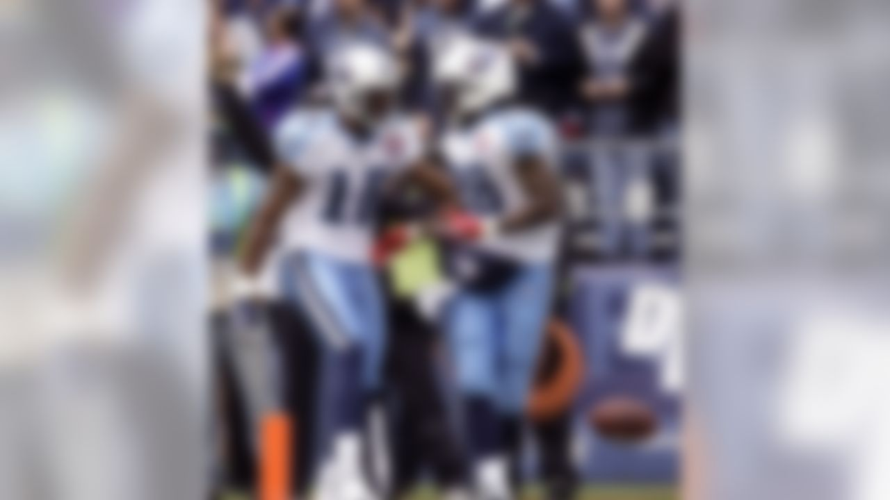 Tennessee Titans' Chris Johnson, right, celebrates his touchdown against the Seattle Seahawks with Titans' Kenny Britt, left, in the first quarter of an NFL football game, Sunday, Jan. 3, 2010, in Seattle. (AP Photo/Elaine Thompson)