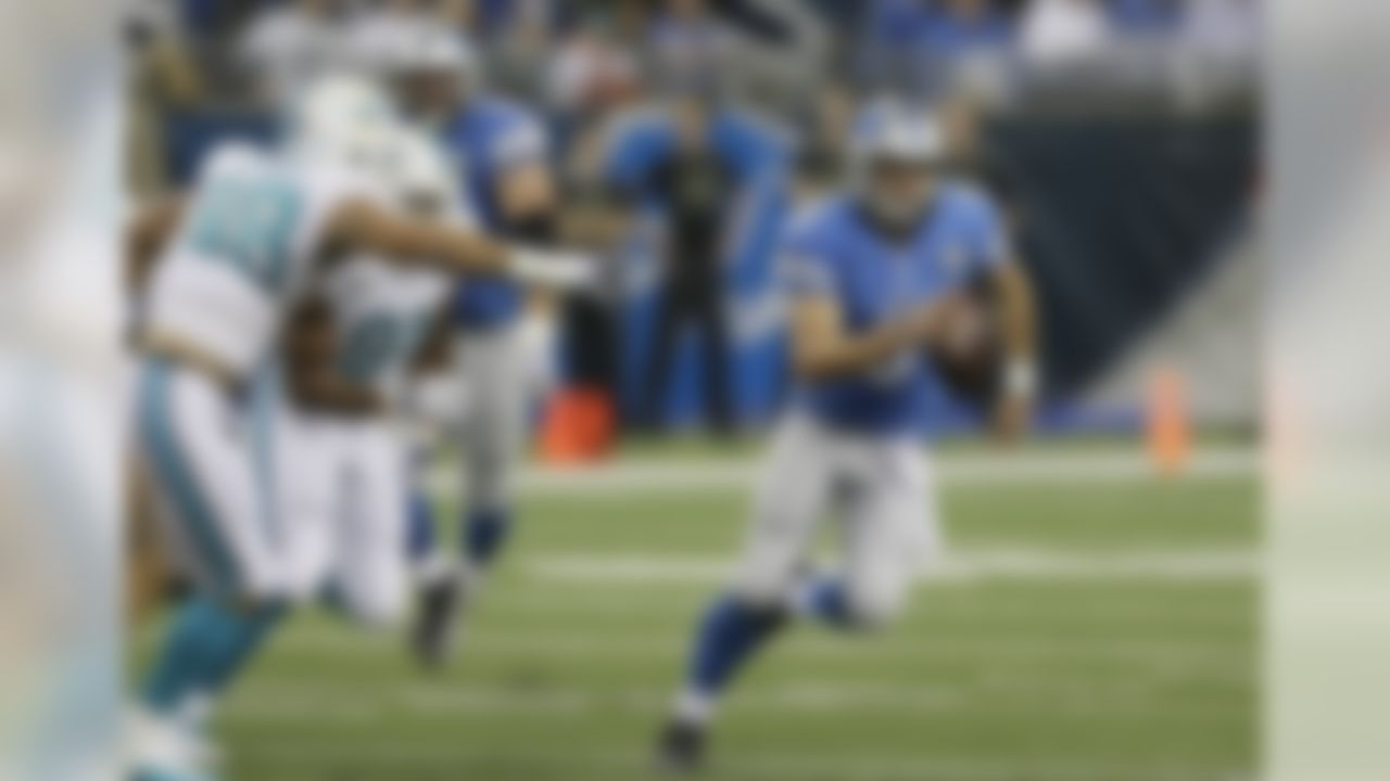 Miami Dolphins defensive tackle Jared Odrick (98) forces Detroit Lions quarterback Matthew Stafford (9) to scramble during the first half of an NFL football game in Detroit, Sunday, Nov. 9, 2014. (AP Photo/Carlos Osorio)