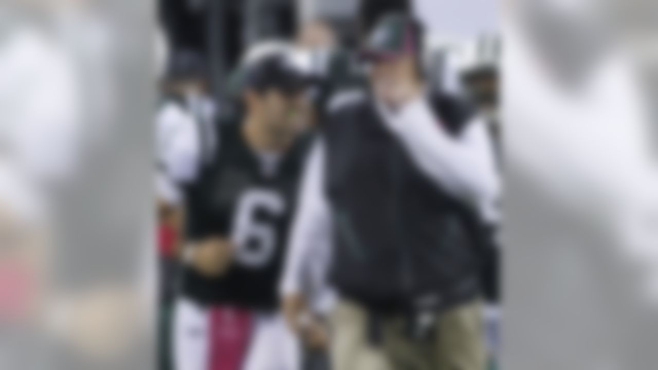 New York Jets quarterback Mark Sanchez, left, and coach Rex Ryan celebrate after the Jets scored late in the fourth quarter of an NFL football game against the Minnesota Vikings early Tuesday, Oct. 12, 2010, in East Rutherford, N.J. The Jets won 29-20. (AP Photo/Seth Wenig)