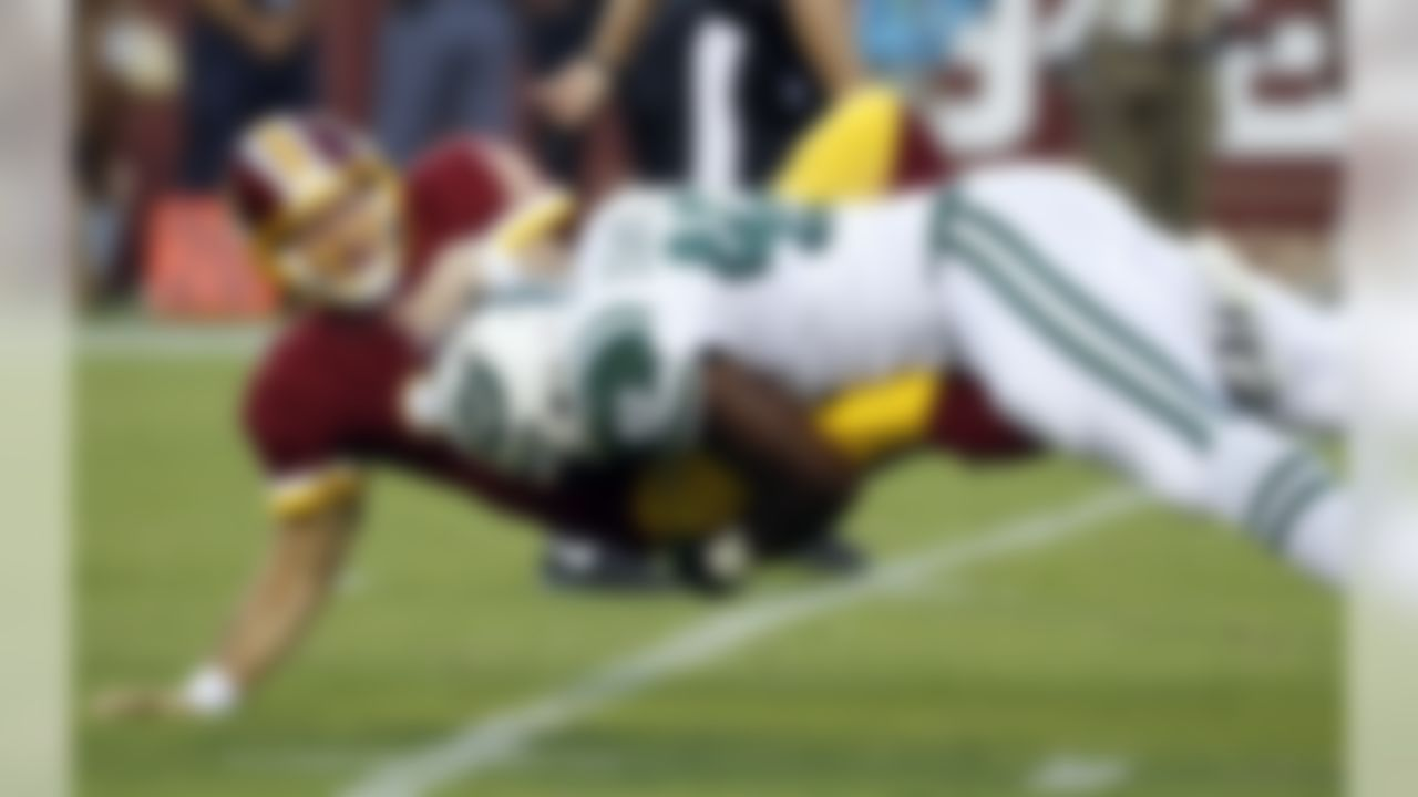 Washington Redskins quarterback Colt McCoy (16) is hit by New York Jets outside linebacker Jordan Jenkins (48) after McCoy threw a pass during the first half of an NFL preseason football game Friday, Aug. 19, 2016, in Landover, Md. (AP Photo/Alex Brandon)
