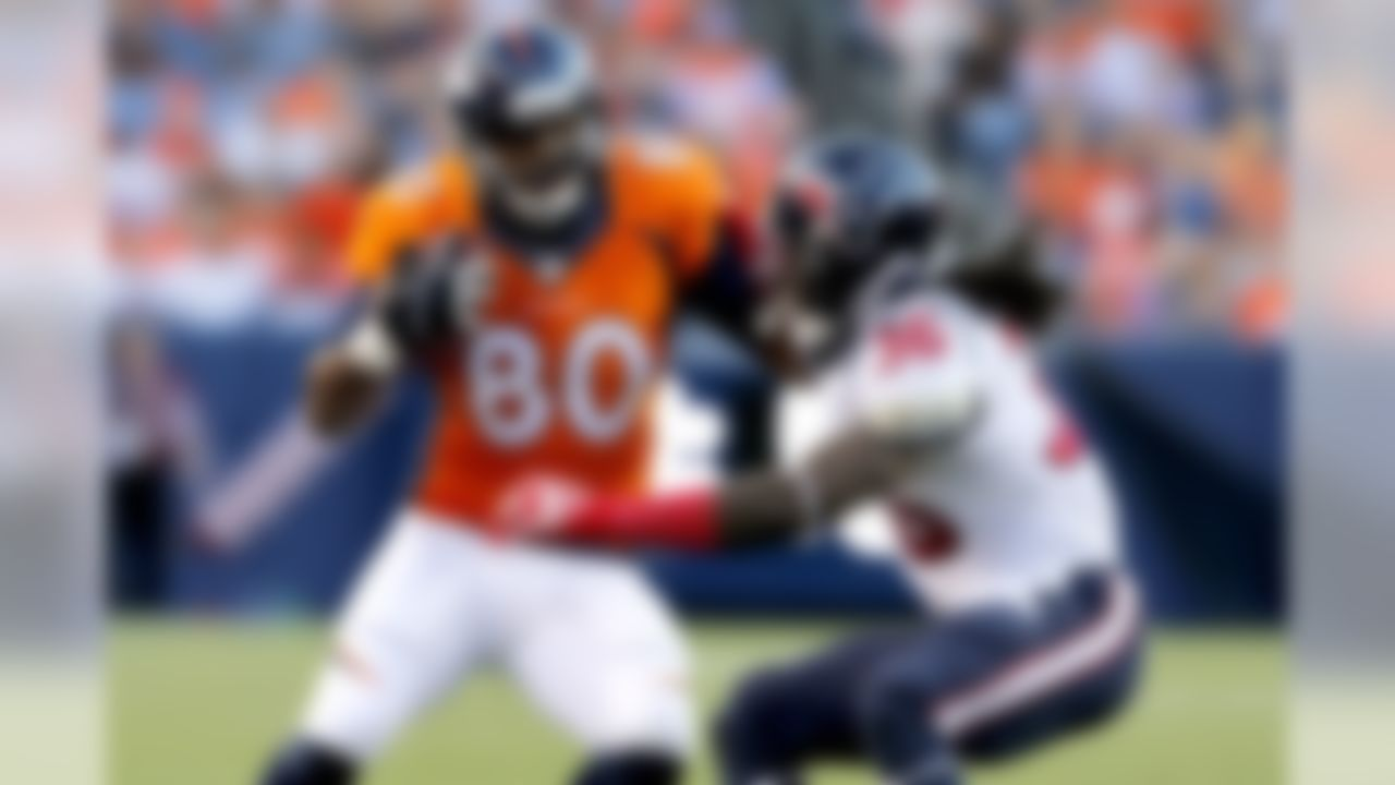 Denver Broncos tight end Julius Thomas (80) is tackled by Houston Texans strong safety D.J. Swearinger (36) during the first half of an NFL preseason football game, Saturday, Aug. 23, 2014, in Denver. (AP Photo/Joe Mahoney)