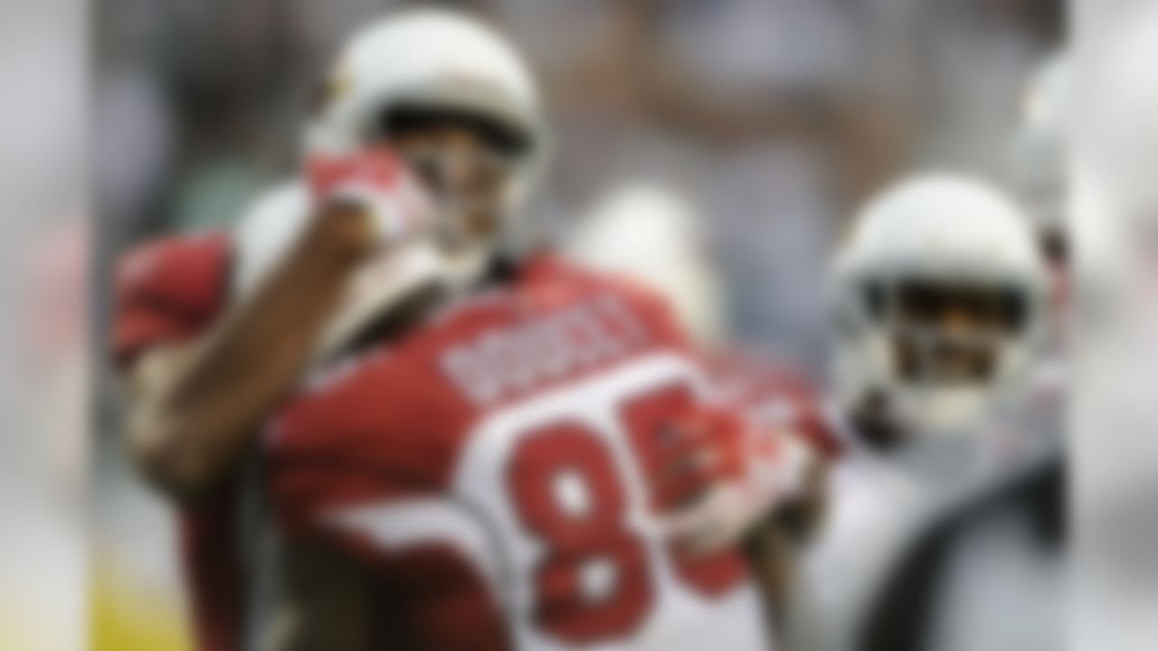 From left to right, Arizona Cardinals' Larry Fitzgerald, Early Doucet and Chansi Stuckey celebrate after Doucet's touchdown in the second half of an NFL football game against the Philadelphia Eagles, Sunday, Nov. 13, 2011, in Philadelphia. (AP Photo/Michael Perez)