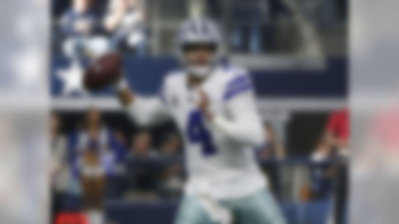 Dallas Cowboys quarterback Dak Prescott (4) looks to throw against the Philadelphia Eagles during the first half of an NFL football game, in Arlington, Texas, Sunday, Dec. 9, 2018. (AP Photo/Ron Jenkins)